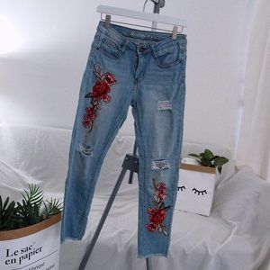 Machine floral embroidered destroyed jeans